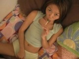 Gorgeous Asian babe sucks on lollipop